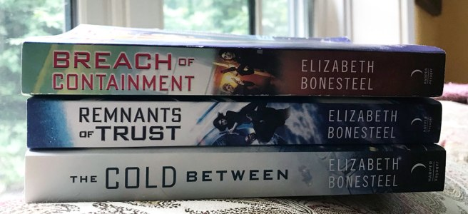 Three series books in a stack